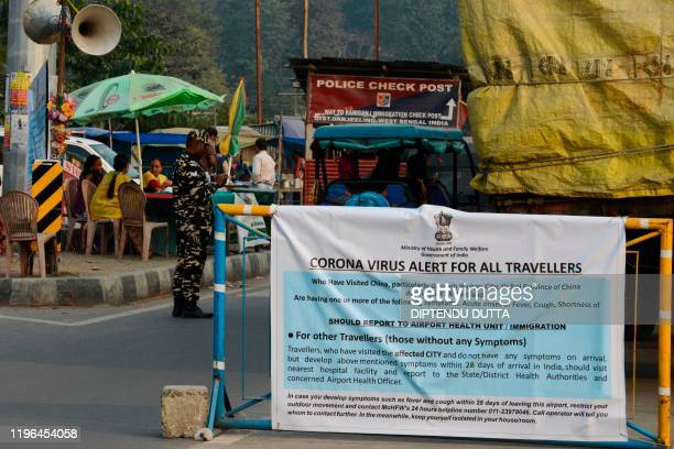 A banner placed by Indian health workers is seen during a Corona virus informarion camp for travellers at an IndiaNepal border crossing some 32 kms...