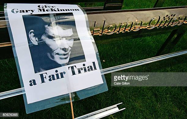 A banner placed by the Home Office plaque at a peaceful demonstration held in support of British computer hacker Gary McKinnon shows his portrait on...