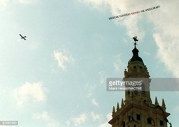A Banner Plane Flies Above The Freedom Tower Pulling A Sign Supporting Janet Reno's Decision To Reunite Elian Gonzalez With His Father April 25 2000...