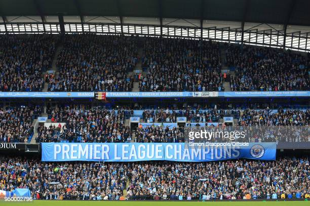 A banner proclaiming Man City as Premier League Champions is unfurled ahead of the Premier League match between Manchester City and Swansea City at...