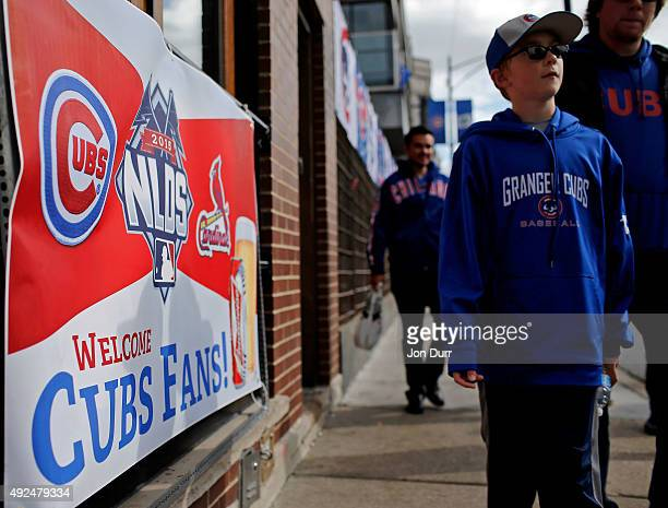 A banner promoting Game Four of the National League Divisional Series between the Chicago Cubs and St Louis Cardinals is seen in front of the bar Red...