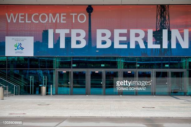 A banner promoting the International Travel Fair is fixed on a building at the fair grounds in Berlin on February 28 2020 Authorities will decide on...