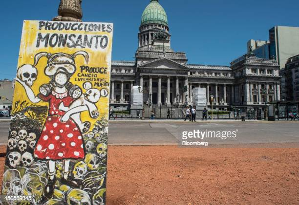 A banner protesting Monsanto Co is displayed in front the Argentine National Congress building in Buenos Aires Argentina on Tuesday Nov 12 2013...