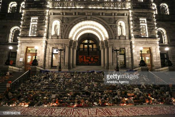"""Banner reading """"1505"""" along with toys and candles placed outside the British Columbia Parliament Building to honour indigenous children died in..."""