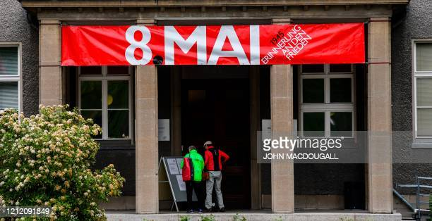 A banner reading 8th of May hangs at the entrance to the GermanRussian museum in the Berlin district of Karlshorst on May 7 2020 The building now...
