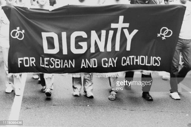 A banner reading 'Dignity for Lesbian and Gay Catholics' at a May Day gay rights march in New York City USA 1st May 1980