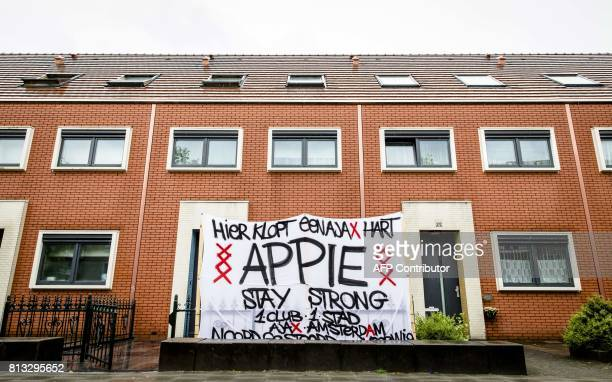 A banner reading 'Here beats a Ajax heart Stay Strong Appie' stands in the garden in front of the house of Ajax Amsterdam footballer Abdelhak Nouri...