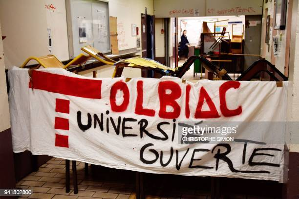 A banner reading in French 'Tolbiac open university' is displayed on tables and chairs set up as a barricade inside the Paris 1 Pantheon Sorbonne...