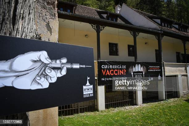 "Banner reading in Romanian ""Who's afraid of vaccine"" and depicting syringes as vampire fangs advertises the vaccination marathon organised at the..."