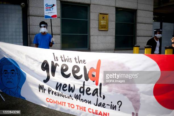 A banner reading Is this the greed new deal Mr President Moon Jaein during the AntiEnergy Rally Activists staged a rally infront of the South Korean...