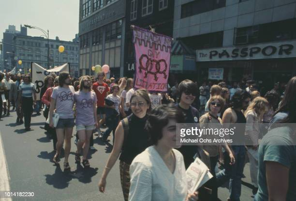 A banner reading 'Ithaca NY Gay Liberation' at an LGBT parade through New York City on Christopher Street Gay Liberation Day 1971