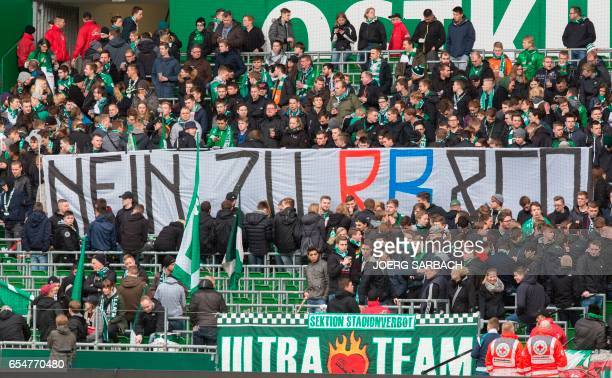 A banner reading 'Nein zu RB Co ' is seen prior to the German First division Bundesliga football match Werder Bremen vs RB Leipzig in Bremen on March...
