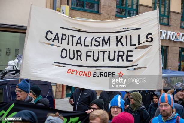 Banner reading quot Capitalism kills our Future quot As in thousands of other cities around the world ten thousands demonstrated for climate justice...
