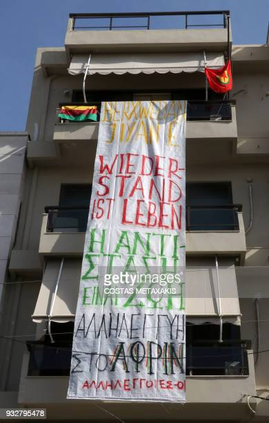 A banner reading 'Resistance is life solidarity to Afrin' hangs at the German Consulate in Heraklion Crete Island on March 16 after a group of...