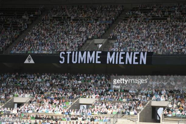 """Banner reading """"Silent countenances"""" is seen inside the stadium prior to the Bundesliga match between Borussia Moenchengladbach and Bayer 04..."""