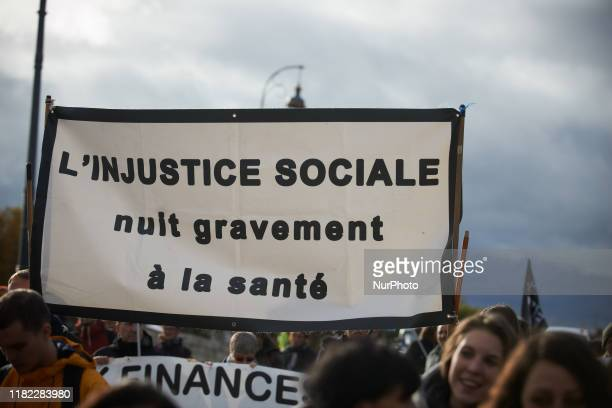 Banner reading 'Social injustice harms your health' All professionnals from french public hospitals took to the streets for another day of action as...