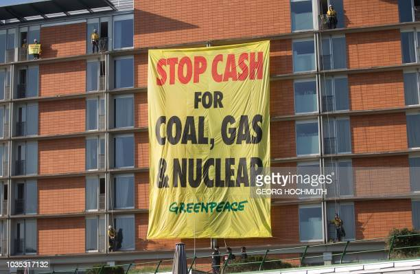A banner reading Stop cash for coal gas nuclear fixed by Greenpeace activists can be seen prior to an informal meeting of EU energy ministers in Linz...