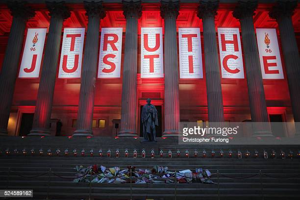 Banner reading Truth and Justice is hung from Liverpool's Saint George's Hall and illuminated in red after today's Hillsborough inquest verdict on...