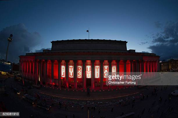 A banner reading Truth and Justice is hung from Liverpool's Saint George's Hall and illuminated in red after a vigil for the 96 victims of the...