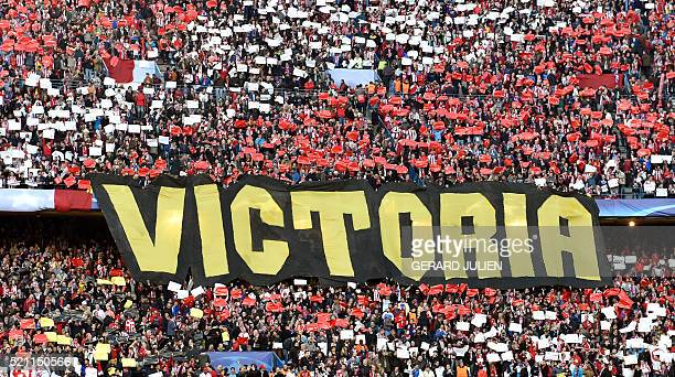 A banner reading 'Victory' is displayed by the Atletico's fans prior the Champions League quarterfinal second leg football match Club Atletico de...