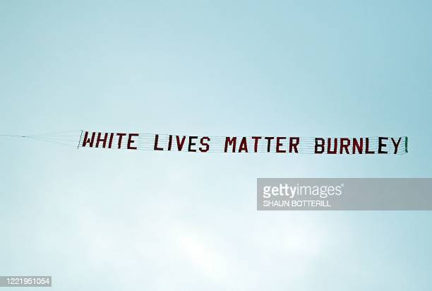 TOPSHOT A banner reading 'White Lives Matter Burnley' is towed by a plane above the stadium during the English Premier League football match between...