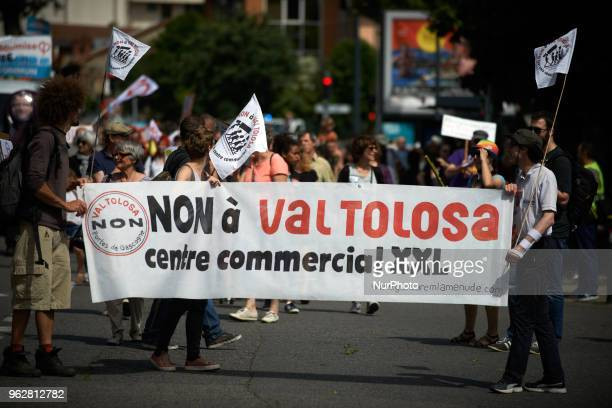 A banner reads 'No to Val tolosa giant commercial center' Val Tolosa is a place near Toulouse where UnibailRodamco plans to build a giant mall...