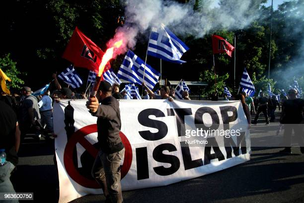 A banner reads Stop Islam during a rally held by Golden Dawn members and supporters in Syntagma square in Athens Greece on May 29 2018 to commemorate...
