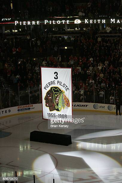 Banner retiring the number of former Chicago Blackhawks defenseman and NHL hall of famer Pierre Pilote is raised during a ceremony before the Chicago...