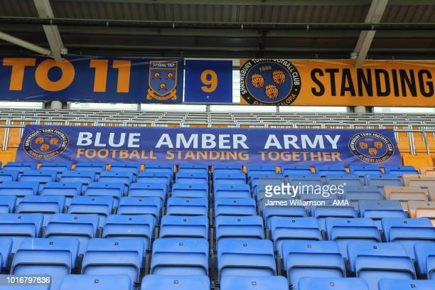 Banner saying blue amber army Football standing together attached to the front of the Safe standing area during the Sky Bet League One match between...