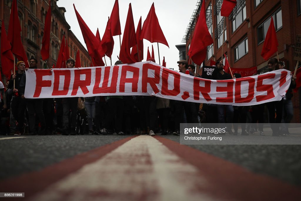 A banner saying 'Forward, Reds!' is held up as people take part in anti-Brexit and anti-austerity protests as the Conservative party annual conference gets underway at Manchester Central on October 1, 2017 in Manchester, England. Five-hundred thousand people are expected to take part in the protests with police mounting an unprecedented security operation of a thousand officers and extra armed police to protect Conservative party conference delegates.