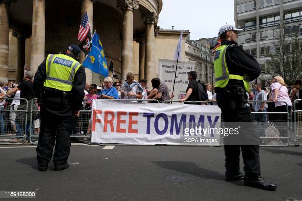 A banner saying Free Tommy during the rally in London Supporters gathered outside BBC to demand the freedom of their jailed rightwing leader Stephen...