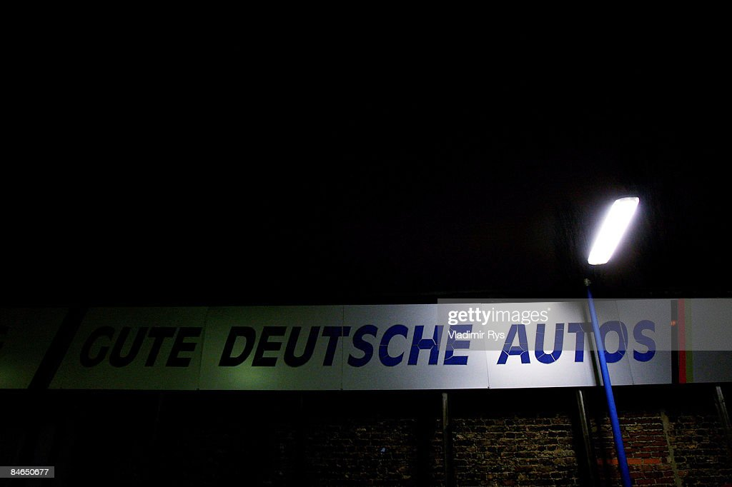 2dfd45cec0 A banner saying  Good German Cars  is seen by night over an half ...