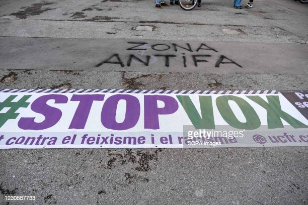 Banner saying Stop VOX is seen on the ground in Passeig de Gràcia against the far-right VOX party led by Santiago Abascal. Anti-fascist militants...