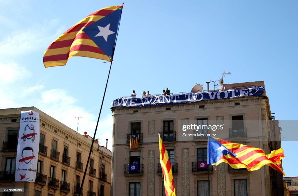 A banner saying 'we want to vote' is seen while Catalan Independence supporters wave Esteladas (Catalan pro-independence flag) during a demonstration of Catalan Mayors backing Independence Referendum on September 16, 2017 in Barcelona, Spain. 712 Catalan mayors who have backed the independence referendum were summoned by Spain's State Prosecutor over the independence vote, threatening arrests over non-cooperation. The vote on breaking away from Spain was called by the Catalan government for October 1, 2017 but was suspended by the Spanish Constitutional Court following a demand from the Spanish Government. Catalan and Spanish security forces have been instructed by Spain's Public Prosecutor's Office to take all the elements which could promote or help to celebrate the referendum. This includes ballots, ballots boxes and promotional material.