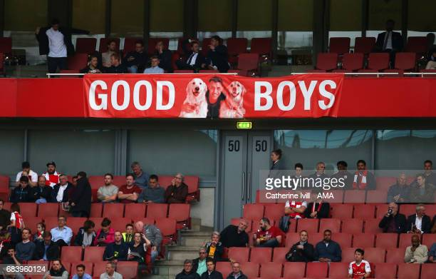 A banner showing a picture of Alexis Sanchez of Arsenal and his dogs during the Premier League match between Arsenal and Sunderland at Emirates...