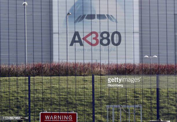 A banner showing an Airbus A380 aircraft sits on an exterior of the Airbus SE plant in Broughton UK on Thursday Feb 14 2019 Airbus Chief Executive...