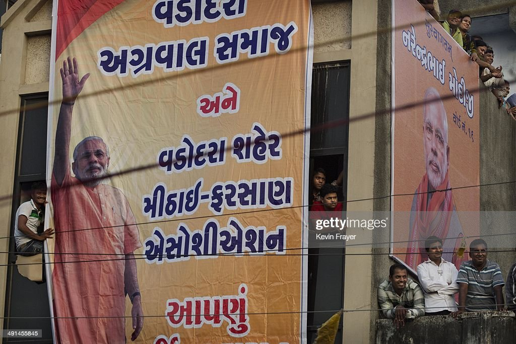 A banner showing BJP leader Narendra Modi is seen during a speech by Modi after his landslide victory in elections on May 16, 2014 in Vadodara, India. Early indications from the Indian election results show Mr Modi's Bharatiya Janata Party was ahead in 277 of India's 543 constituencies where over 550 million votes were made, making it the largest election in history.