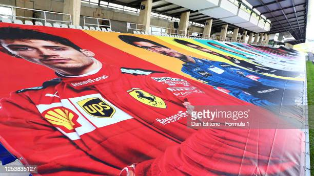 A banner showing Charles Leclerc of Monaco and Ferrari is seen in a grandstand during previews for the F1 Grand Prix of Austria at Red Bull Ring on...
