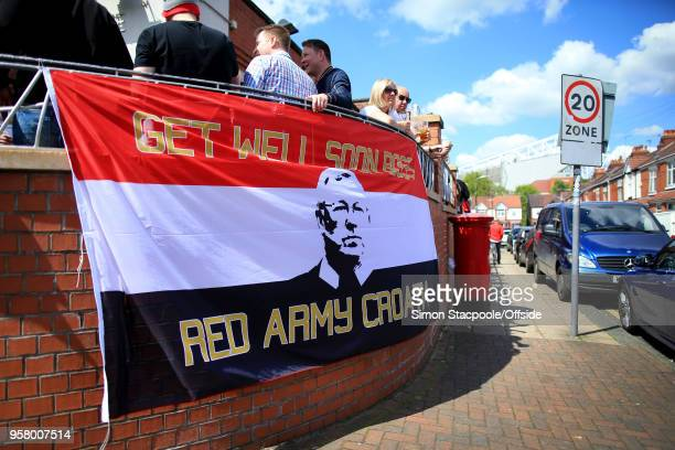 A banner showing support for former Man Utd manager Sir Alex Ferguson is displayed ahead of the Premier League match between Manchester United and...