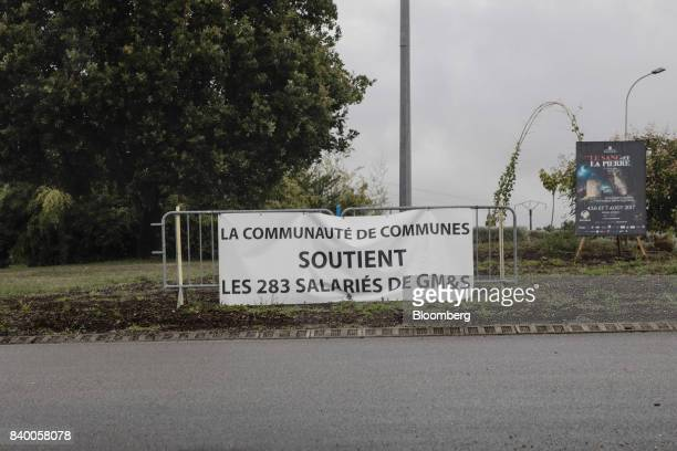 A banner showing support for GMS workers sits near the GMS automobile parts factory in La Souterraine La Creuse region France on Monday July 24 2017...