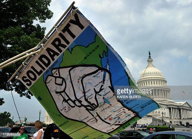 A banner showing the state of Wisconsin in the shape of a fist for union solidarity is seen July 28 2011 during a protest against the debt ceiling...