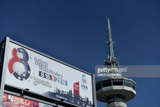 A banner stands next to the telecommunication tower the symbol of the Thessaloniki International Fair in Thessaloniki on September 6 with the US this...
