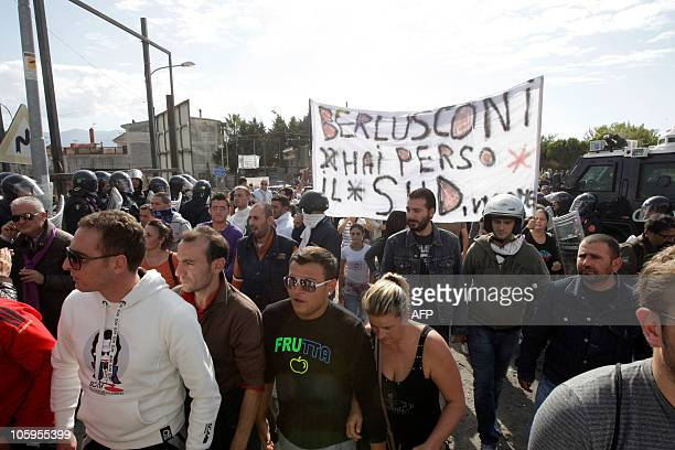 A banner stating Berlusconi you have lost the south of Italy is held in Boscoreale near Naples on October 22 2010 People are protesting against the...