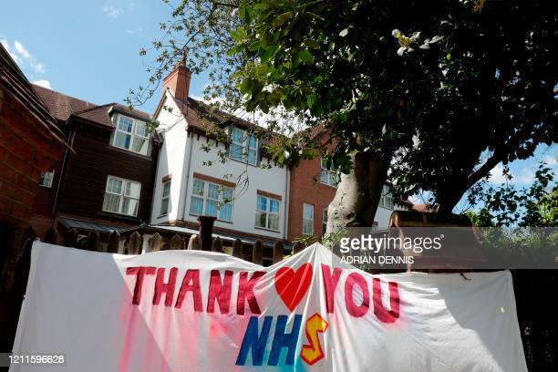 A banner thanking all key workers is seen outside the Sunrise Senior Living care home in Esher southwest of London on May 2 2020 as life in Britain...