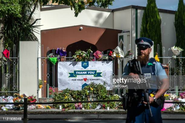 A banner thanking wellwishers for their support hangs from the fence of Al Noor mosque as an armed police officer patrols outside on March 22 2019 in...