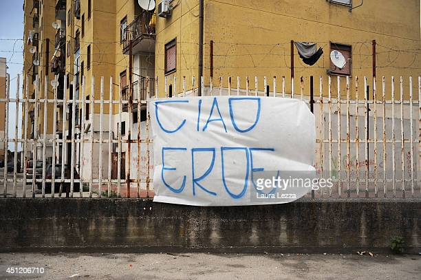 A banner that reads Ciao eroe dedicated to Ciro Esposito a Napoli fan died this morning is displayed on June 25 2014 in the neighborhood of Scampia...