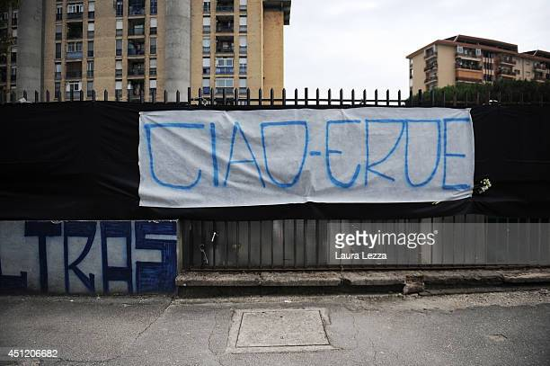 A banner that reads 'Ciao eroe' dedicated to Napoli fan Ciro Esposito who died this morning is displayed outside the car wash where he worked on June...