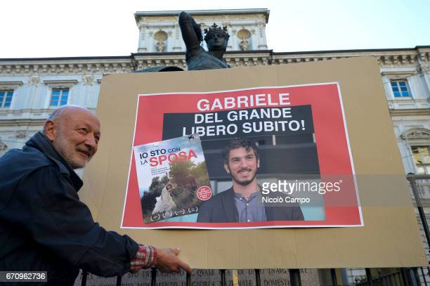 A banner to demand freedom for Gabriele Del Grande is shown during a rally to demand the release of the Italian journalist blogger writer and human...
