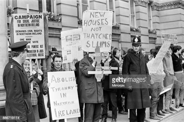 Banner waving demonstrators protest outside Birmingham Council House during a civic reception for people who helped the city's Ulster Week 24th April...