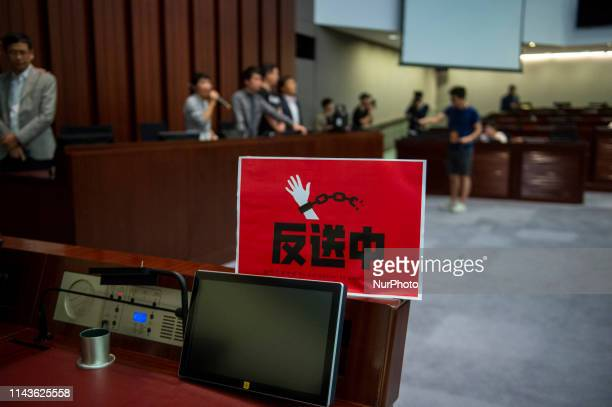 A banner which read quotAgainst extradition lawquot is seen on a desk of Legco Member inside a meeting room in Hong Kong China 14 May 2019 Hong...